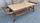 Grande table basse en bambou, fixations en rotin, plateau imitation bois clair, en excellent état de conservation. Pour ajouter une touche ethnique à votre décoration, à utiliser en table de salon ou bout de lit.